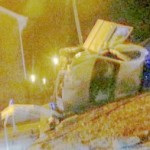 Three police officers miraculously escaped injury when their car crashed