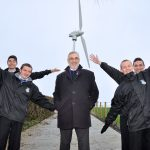 Philip Rainey, Simple Power (centre) is pictured alongside Nathan Garland-O'Neill, David Curran, Ryan Hanna and Mark Quigley from Corpus Christi College, as they visited the company's single wind turbine at Jim McCord's farm
