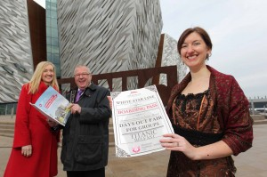 ALL ABOARD... Dawn Hewitt and Willie Lougheed from the Northern Ireland Tourist Board (NITB) join Titanic Belfast tour guide Whitney Rozelle as they launch NITB's popular 'Great Days Out Fair' which returns on Saturday February 15.