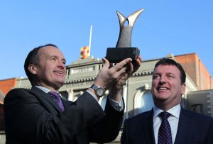 NITB Chairman, Howard Hastings (left) with a Northern Ireland Tourism Award and Paddy McKenna from Diageo NI at this years' venue, the Ulster Hall.