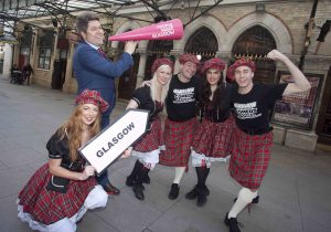 A GIGGLE IN GLASGOW: Bruce Devlin, well known Scottish comedian is pictured with his troupe of dancers who are promoting the Glasgow International Comedy Festival