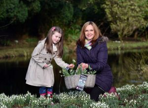 NITB's Elaine Groves along with Anna Phenix (7) from Belfast explore the snowdrops around Benvarden Garden in Dervock