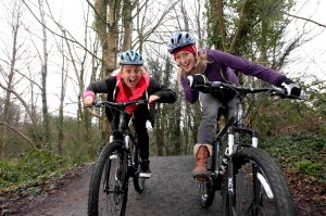 Winter Olympic Snowboarder Aimee Fuller, who lives in Northern Ireland, along with the Northern Ireland Tourist Board's Julie McLaughlin take to their bikes at the Barnett Demesne Mountain Bike Trail,