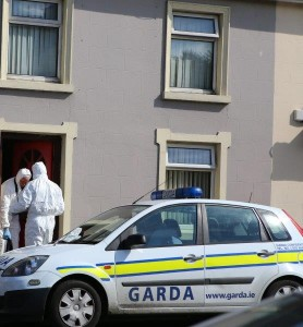 Forensic experts at the scene of death at house party