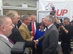 Fancy meeting you here? Nigel Farage and Peter Robinson shake hands at Balmoral Show