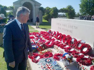 First Minister Peter Robinson has attended the 70th D-Day commemorations in Normandy.  He is pictured following a service at Bayeux Cemetry. PIC: PRESSEYE