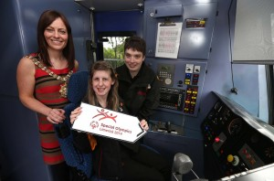 ALL ABOARD:  Lord Mayor, Nichola Mallon, Phoebe Dalrymple and Stephanie Kennedy are in the driver's seat on the way to the Limerick Games