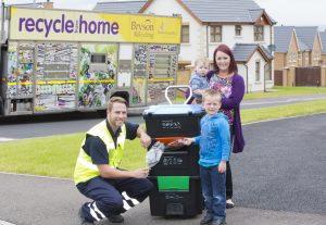L to R Gareth Townsley from Bryson Recycling with Oliver Shields, Danielle Shields and Ethan Shields put Bryson Recycling's new 'Wheelie Box' to test.
