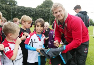 Oliver Tweed (7) from Belfast along with other young players met Ulster Rugby hero Chris Henry during this year's Centra Ulster Rugby Summer Camp at Stormont Sports Pavillion.