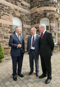 Peter Robinson and  Martin McGuinness pictured with Padraic Quirk, Atlantic Philanthropies