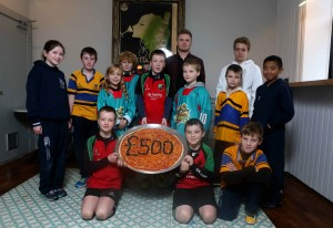 Pictured left to right: Bangor Rugby Club players , City of Belfast Swimming Club players, Junior Belfast Giants players, Holywood Rugby Football Club players join Luke Wolsey, MD of Little Wing Pizzeria at the new Holywood Little Wing.