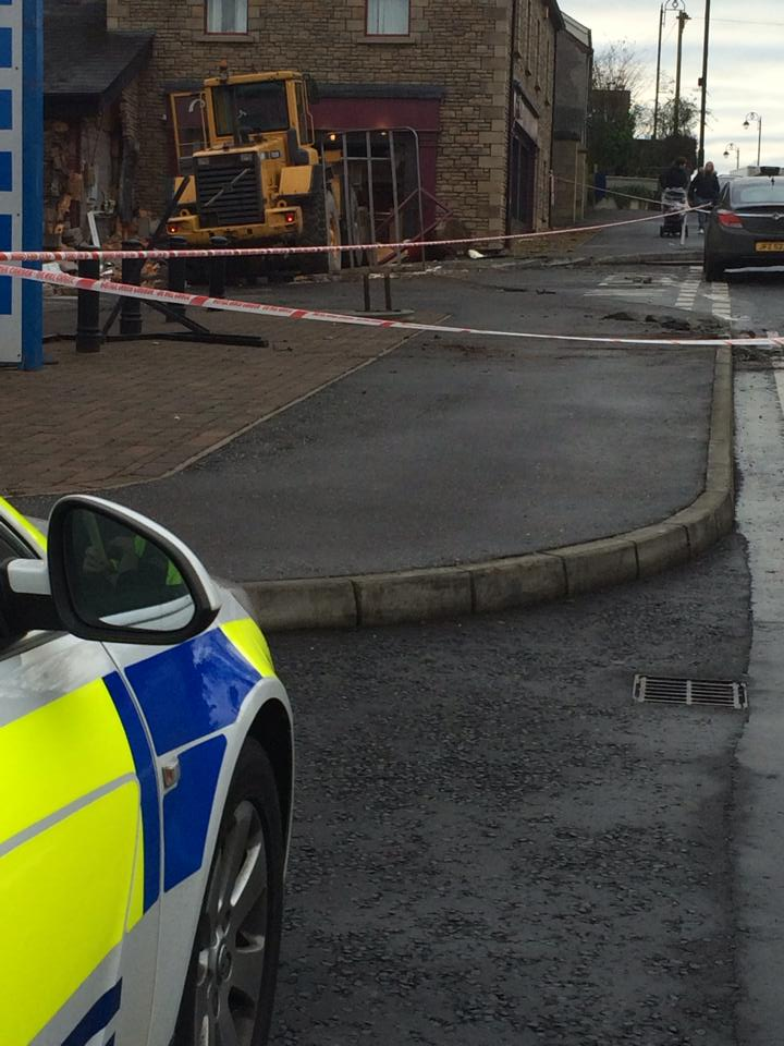 The scene this morning in Co Tyrone after a digger was used to ram an ATM machine