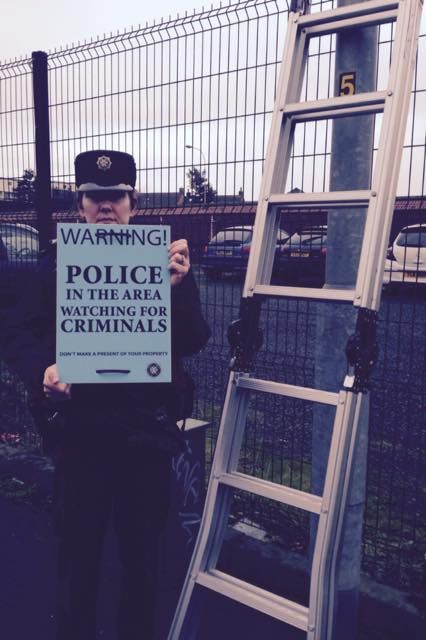 Constable Fiona Rogan with the signs erected to warn motorists of thieves on the prowl