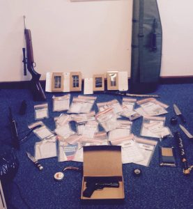 Police put on display the guns, knives, mobile phones and other paraphernalia seized in north Belfast raid