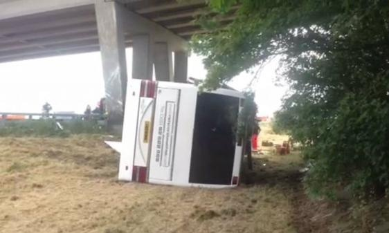 The overturned Richmond coach which crashed into a motorway bridge pillar