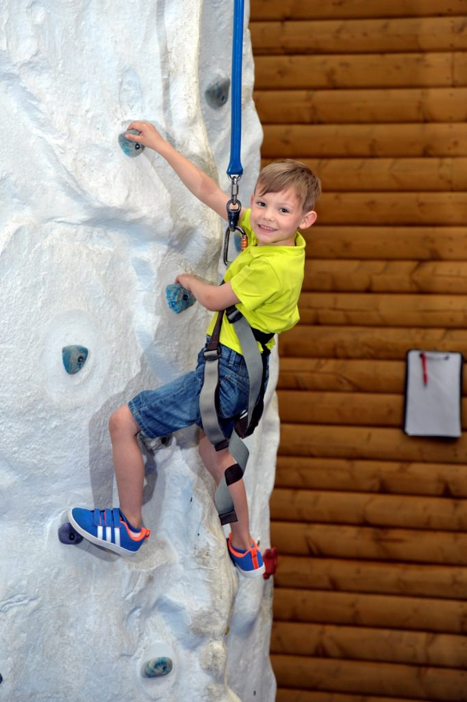 Ned McNally (6) tries his hand at the climbing wall in We Are Vertigo as the Belfast-based trampoline park and adventure centre launches its biggest summer camp to date.