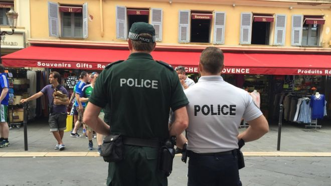 PSNI officers keeping a watchful eye over Northern Ireland supporter enjoying the hospitality in Nice