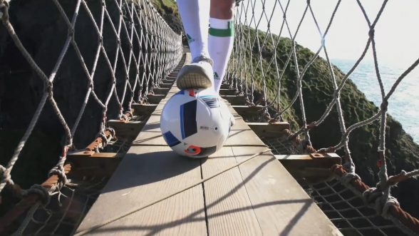 Carrick-a-Rede Rope Bridge, Co Antrim – With kick-off to the European Championship nearly upon us, Tourism Ireland today launched its Euro 2016 campaign, to capitalise on the tourism potential of the tournament. PIC SHOWS: Freestyle footballer Jamie Knight in action on the Carrick-a-Rede Rope Bridge. Pic – Tourism Ireland