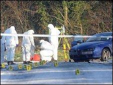 CSI officers examine the scene around Peadar Heffron's Alfa Romeo car