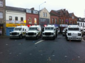 Police landrovers in east Belfast during a stand off with loyalists last December