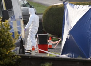 CSI officers comb the murder scene in Ballymena last month