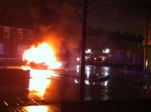 Car on fire in east Belfast during rioting