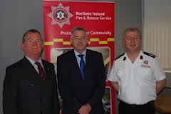NIFRS chief executive Jim Wallace (centre) email staff of Terry McGonigal
