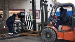 Customs use a forlift truck to remove petrol pumps believed be selling laudered fuel
