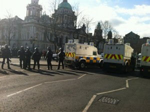 Police in riot gear outside Belfast City Hall on Friday, March 1