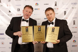 WANTED MEN: Harry Fitzsimons (left) collecting awards with business partner Antonio Valente