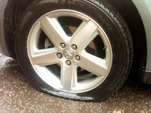 The slashed tyre on a car beloning to an Ulster rugby fan