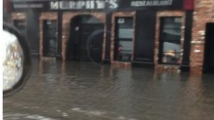 A river of water races past Bartley Murphy's bar in Downpatrick