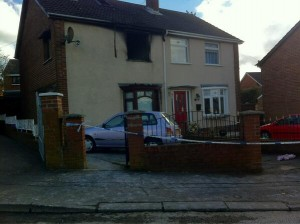 The scene of the blaze in Lenadoon Avenue in west Belfast on Thursday morning