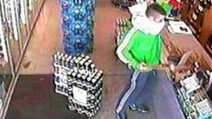 Pink pillow case robber Michael Cassidy robs an off licence with a baseball bat