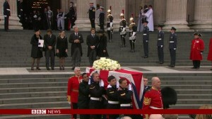 Members of the Armed Forces carry Baroness Thatcher's coffin to a wating hearse