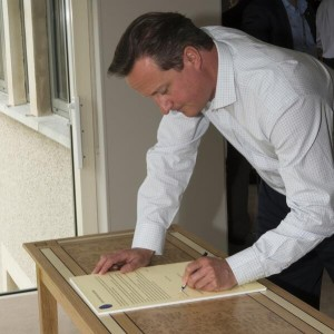 Prime Minister David Cameron signs the Lough Erne Agreement