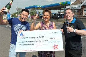 Ryan Dolan (left), brother Sacha (right) and his wife Donna with £76,000 Lotto cheque