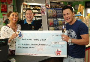 Ryan Dolan (right), brother Sacha (left) with his winning £76,000 Lotto cheque