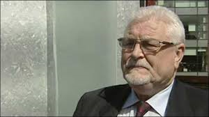 Lord Ken Maginnis is contesting a road rage assault charge against him