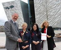 Tim Husbands with visitor experience staff Emma Roddy and Rachael Duncan, and Titanic Belfast Deputy CEO Judith Owens (far right)