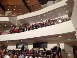 Guests in the Waterfront Hall do a Mexican Wave