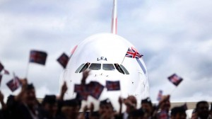 British Airways wave flags in front of a British Airways Airbus A380, the world's largest passenger plane, at Heathrow Airport, as BA became the first UK airline to take delivery of the massive superjumbo.
