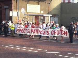 Residents protest outside St Patrick's Church on the Twelfth of July over an Orange Order parade