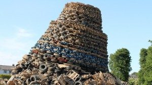TIMBER...Massive bonfire collapses on the Ballycraigy estate