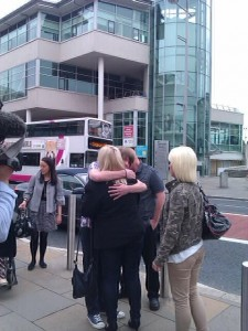 Mary Meehan comforted by family relatives outside Belfast Crown Court on Friday morning