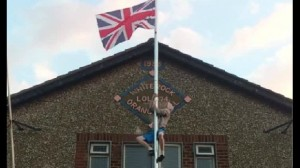 A man captured on video climbing up flag pole at Whiterock Orange Hall