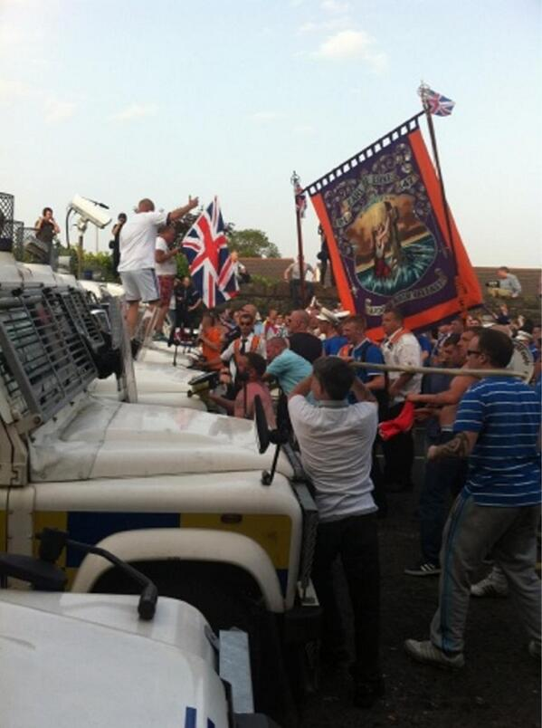 Loyalists attack PSNI landrovers which blocked their return route home on the Twelfth of July
