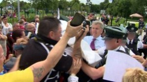 Police had to escort Belfast's Sinn Fein Lord Mayor Mairtin O'Muilleoir from Woodvale on Tuesday