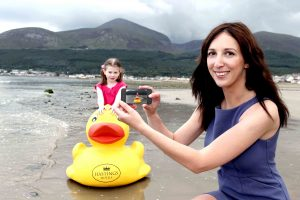 PHOTO TIME... Charlotte Jess from the Northern Ireland Tourist Board (NITB) and Anna Phenix, aged 7, complete one of the tasks during the launch of NITB's MyNI photo competition.