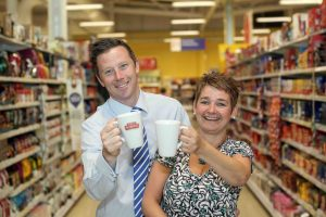 COFFEE BREAK... Maria Losty from Robert Roberts joins Steven Murphy, Buying Manager of Tesco Northern Ireland, as the local tea and coffee company secured a deal to supply its new Dark Roast 'Shipyard Strength' coffee to the retail giant.